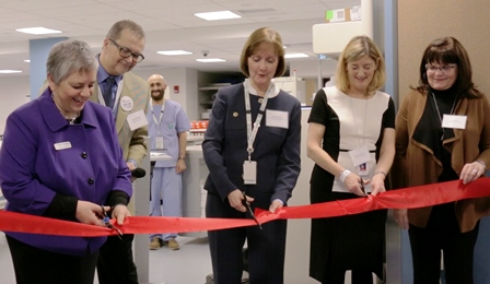 Vivian Eliopoulos, Michele Babich and Mary Ackenhusen cut the ribbon to officially open the Vancouver Pharmacy Production Centre, with assistance from Cathy Figura